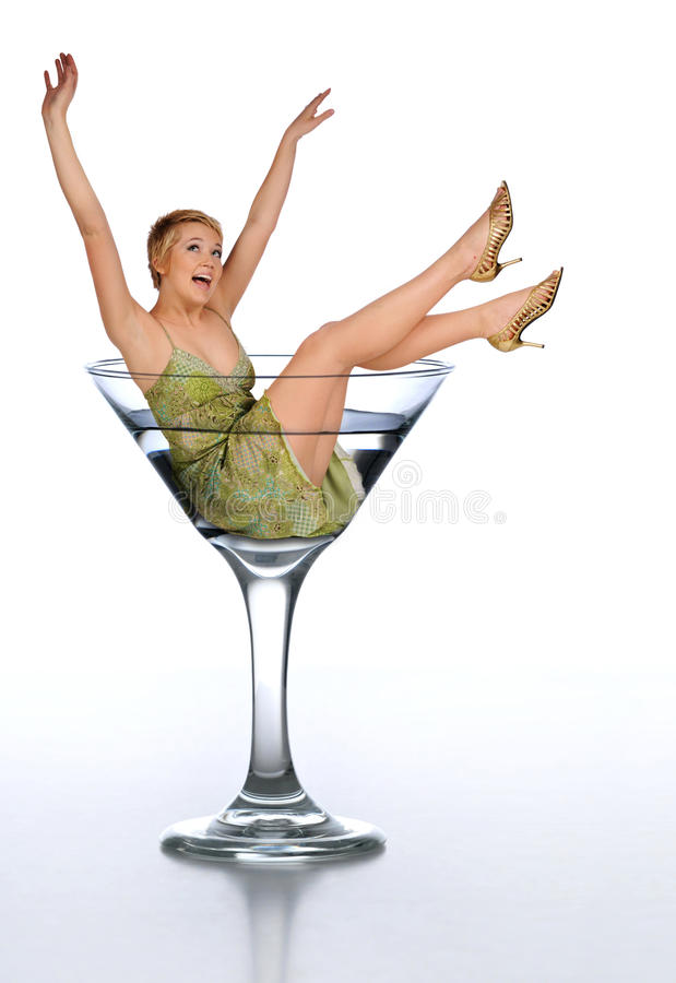 Young woman ina martini glass. Young woman in a martini glass expressing excitement isolated on white royalty free stock photos