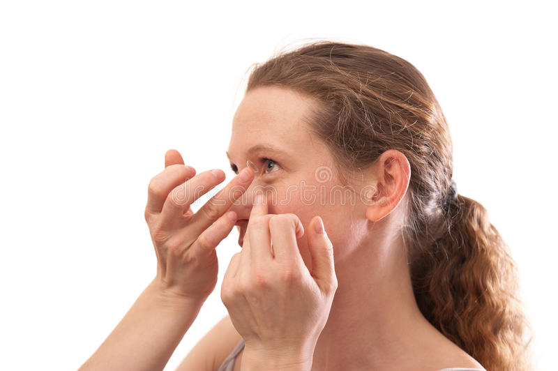 Young Woman Inserting A Contact Lens Royalty Free Stock Photos