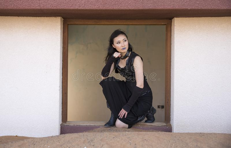 Young woman inside an abandoned house stock images