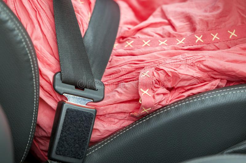 Young woman inside car buckled up with protective seat belt. Safety and precaution concept stock photo