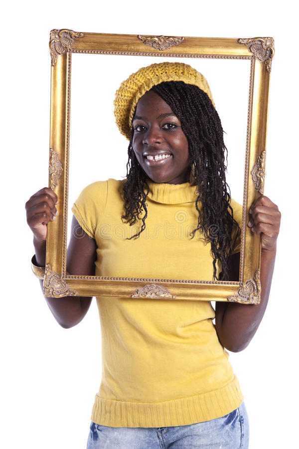 Young woman inside a picture frame royalty free stock photo