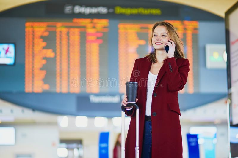 Young woman in international airport stock photography