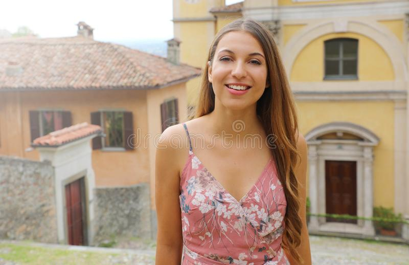 Young woman in Italian old town looks at camera stock photos