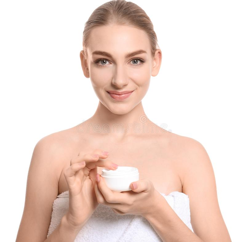 Young woman with jar of body cream. On white background royalty free stock photos