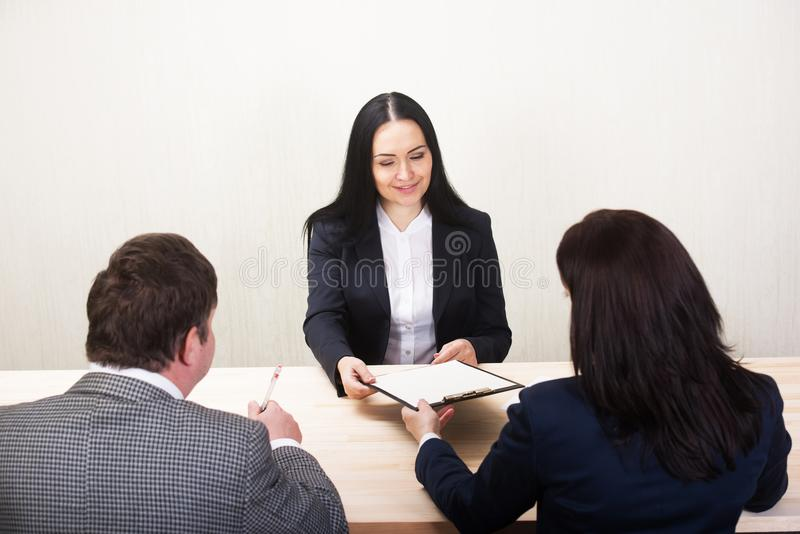Young woman during job interview and members of managemen royalty free stock photography