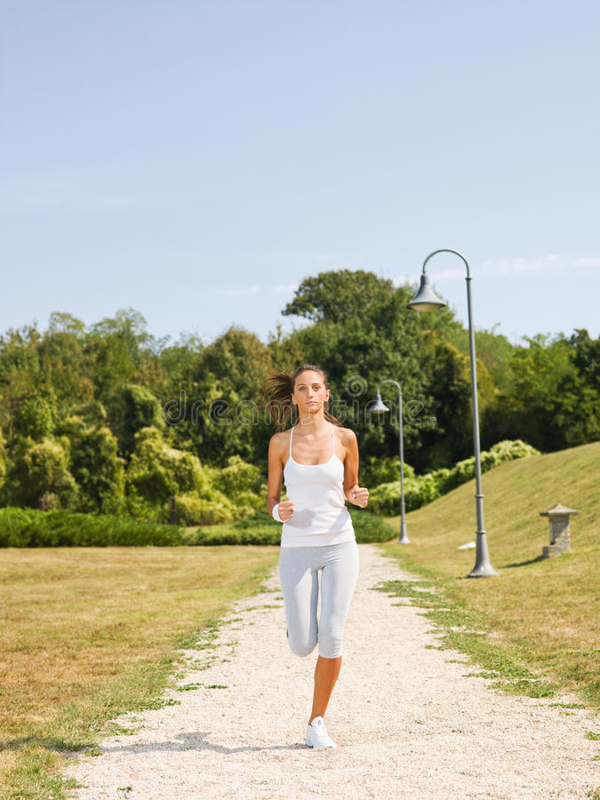 Young Woman Jogging Stock Images