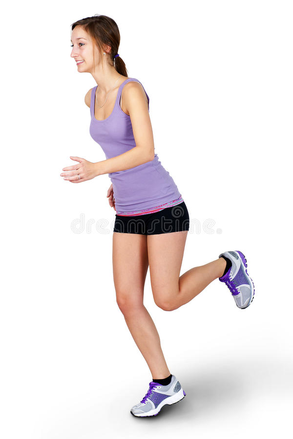 Young Woman Jogging Over White Background Stock Photo