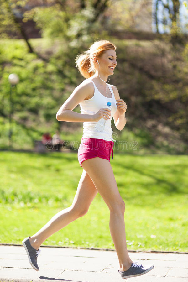 Download Young Woman Jogging In Park Stock Photo - Image: 25404168