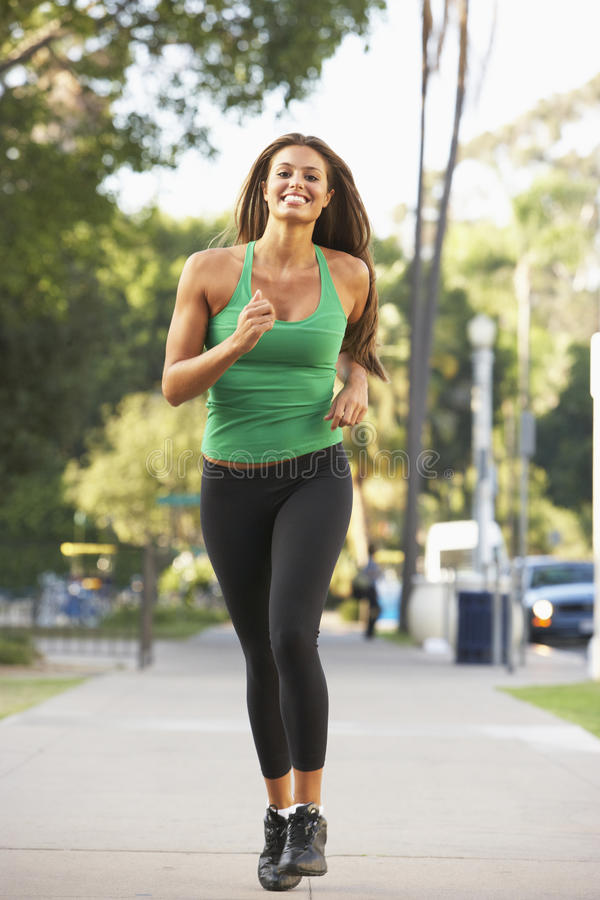 Download Young Woman Jogging On Street Stock Photo - Image: 11502892