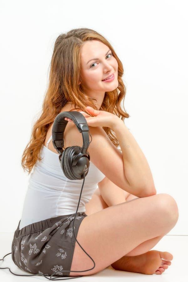 Young woman joyfully listens to audio stock photos