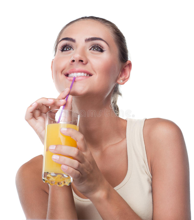 Young woman with juice on white backg royalty free stock photo