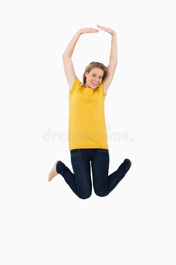 Download Young Woman Jumping Royalty Free Stock Photography - Image: 25335317