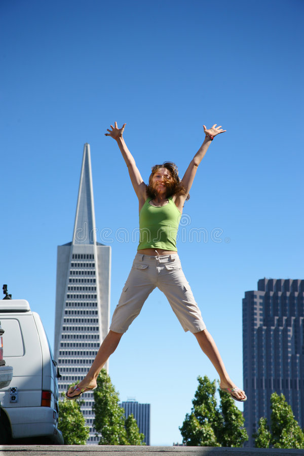 Young woman jumping. In downtown San Francisco stock photo