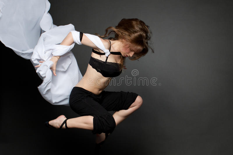 Download Young Woman Jumping From A Developing Tissue. Stock Image - Image: 27275201