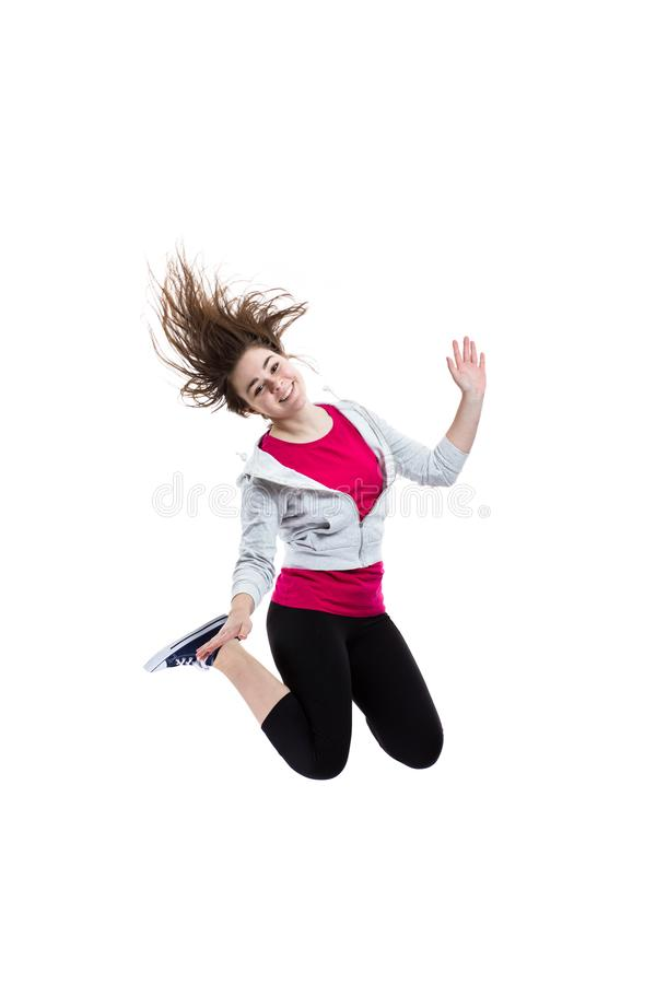 Young woman jumping on white background. Young woman jumping, isolated on white background stock photo