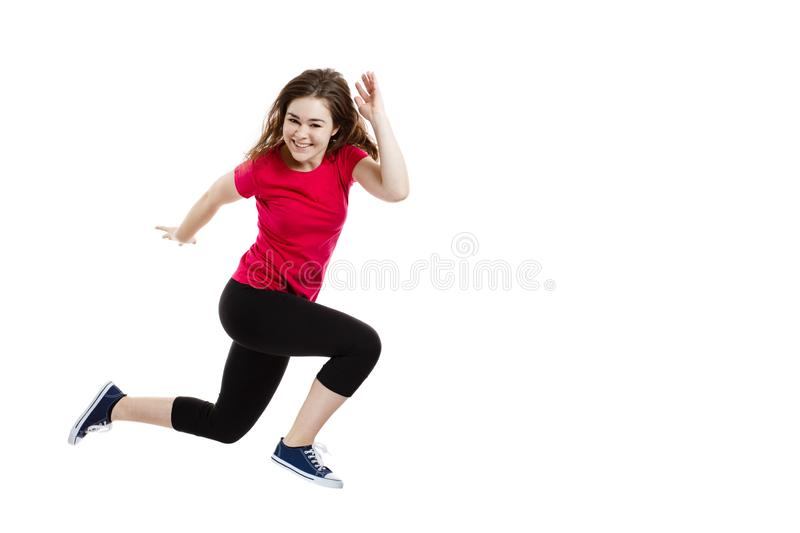 Young woman jumping on white background. Young woman jumping, isolated on white background royalty free stock image