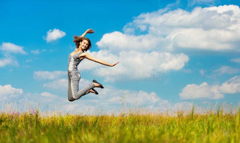 Download Young woman jumps stock image. Image of field, clouds - 21267659