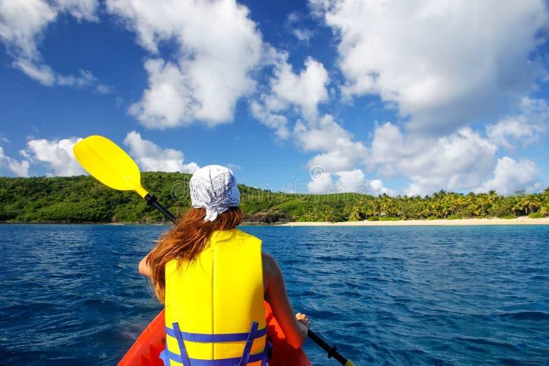 Young woman kayaking near Drawaqa Island in Yasawas, Fiji stock photo