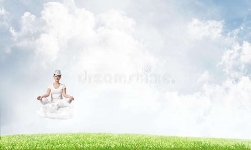 Young woman keeping mind conscious. stock photo