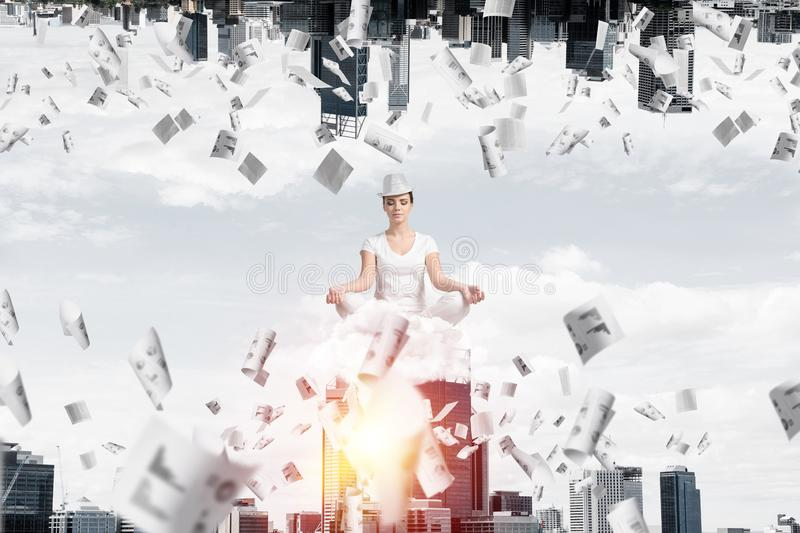 Young woman keeping mind conscious. Young woman keeping eyes closed and looking concentrated while meditating on cloud among flying papers and between two urban vector illustration