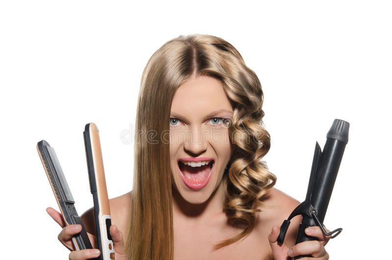 Young woman keeps hair curlers and rectifier. Screaming woman keeps hair curlers and rectifier stock photos