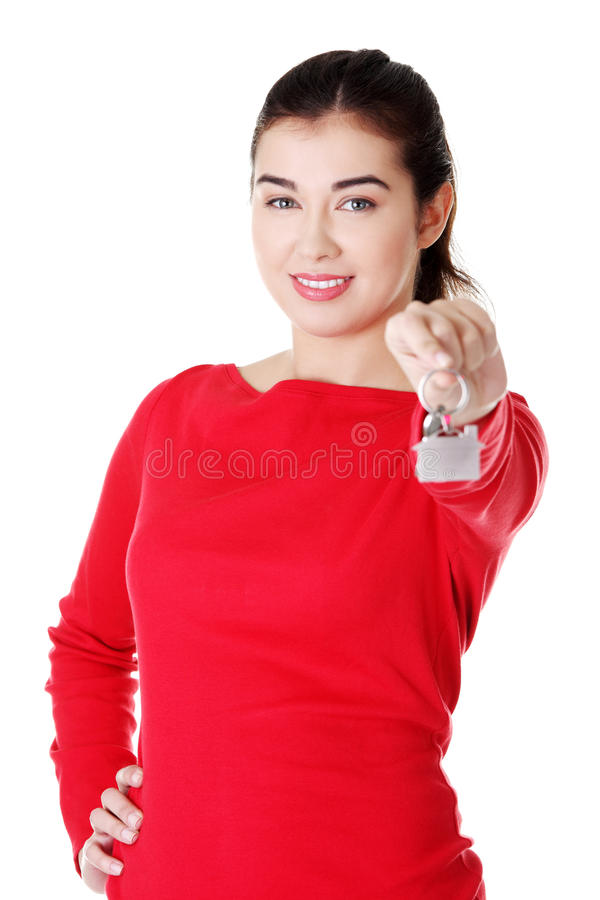 Young woman with keys to her home royalty free stock image