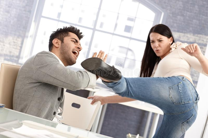 Download Young Woman Kicking Boyfriend Stock Photo - Image: 31219174