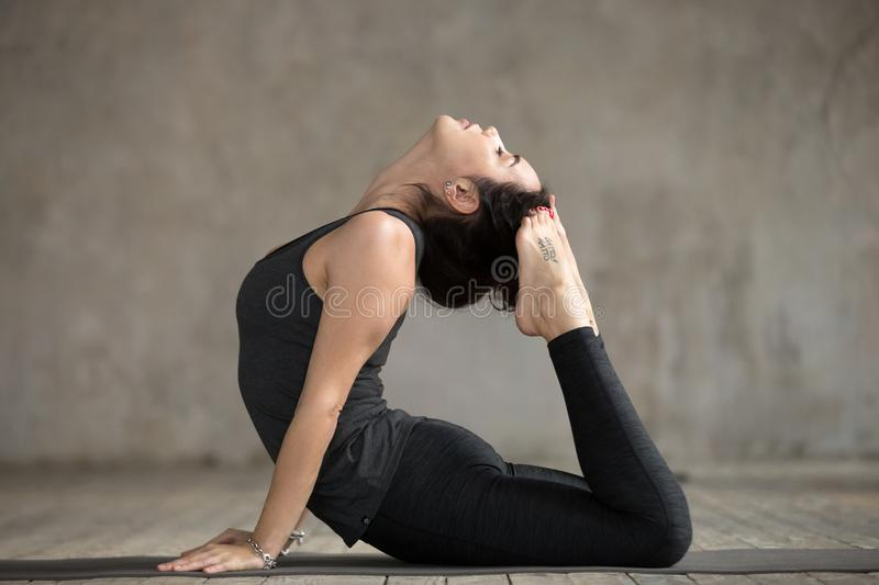 Download Young Woman In King Cobra Pose Stock Photo