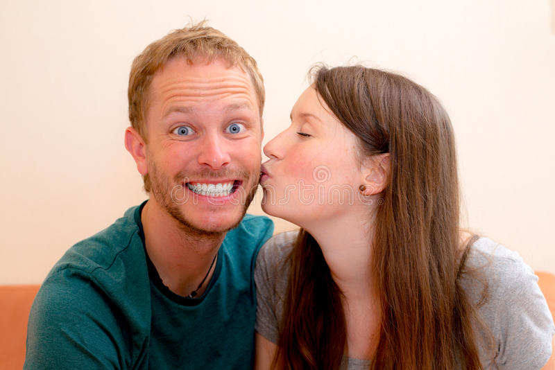 Young woman kissing her boyfriend stock photo