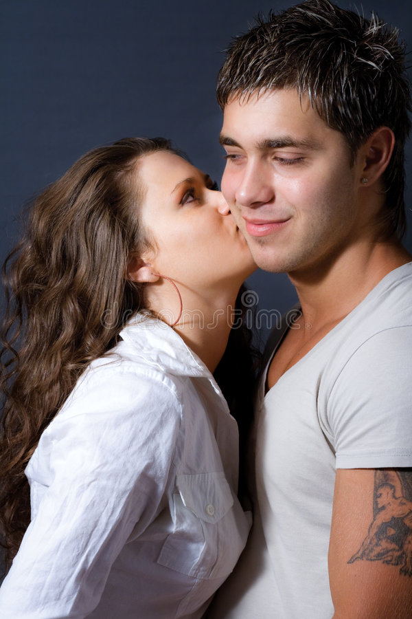 Young woman kissing her lover stock photography