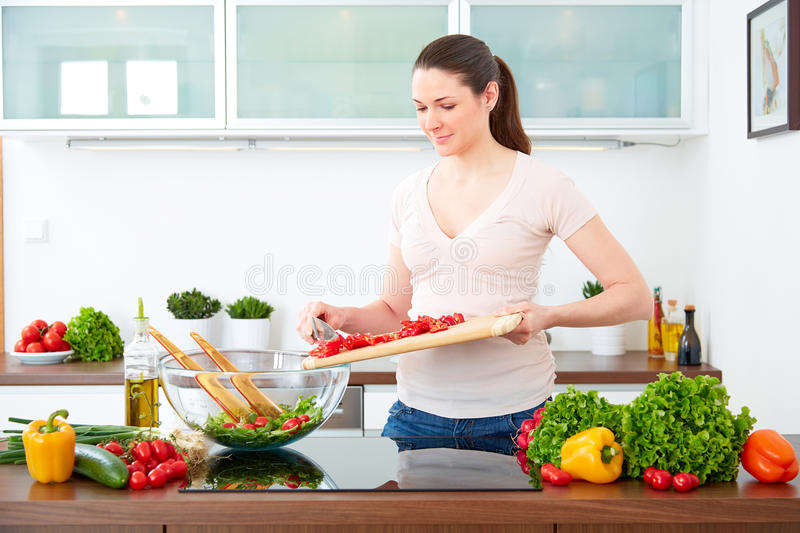 Young woman in the kitchen prepare salad II royalty free stock photography