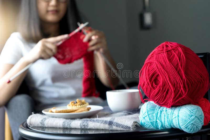 Young woman knitting for her hobby on the bed stock image