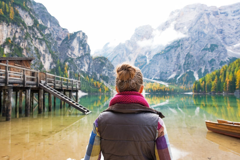 Young woman on lake braies in south tyrol, italy stock photos