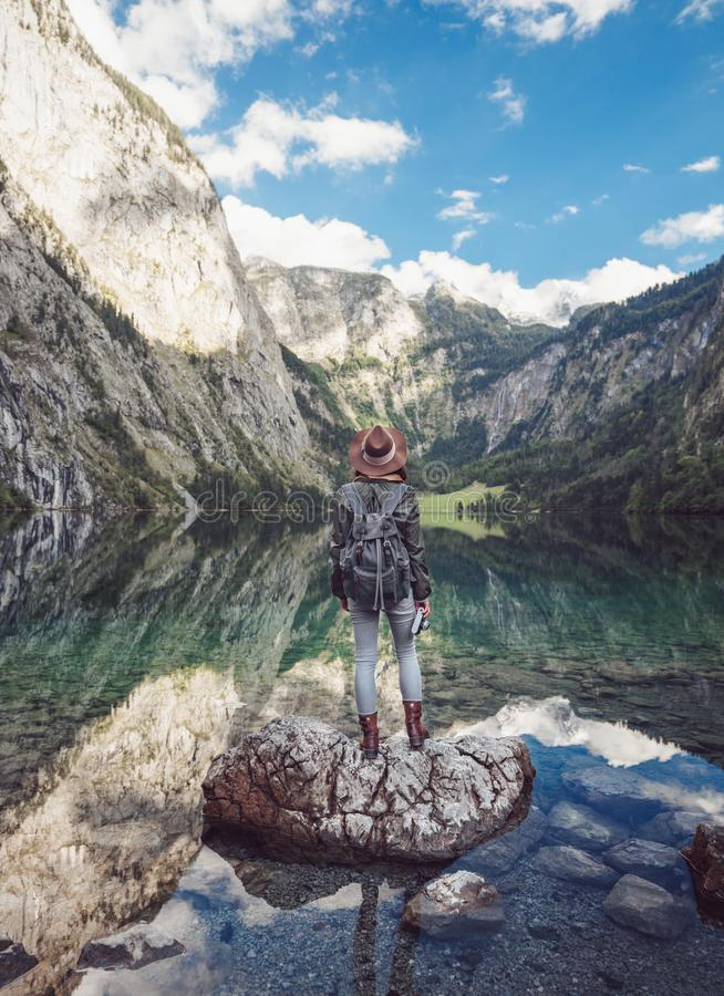 Young woman by the lake in Obersee. Germany royalty free stock images