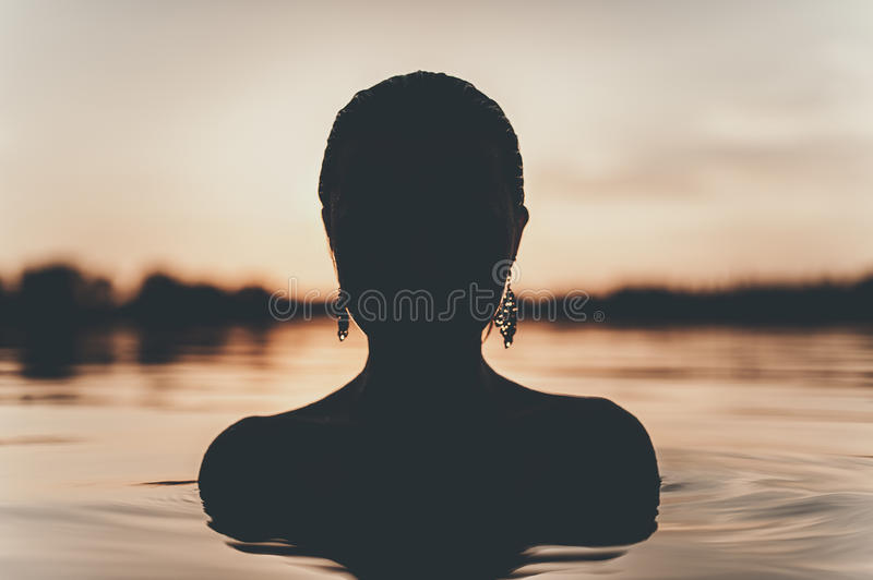 Young woman in lake royalty free stock photo