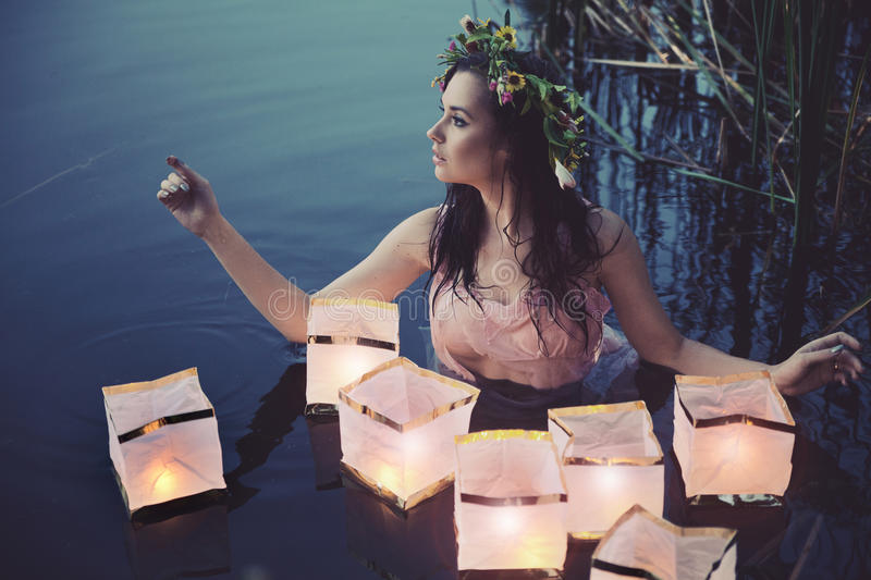 Download Young woman with lanterns stock photo. Image of dress - 26944778