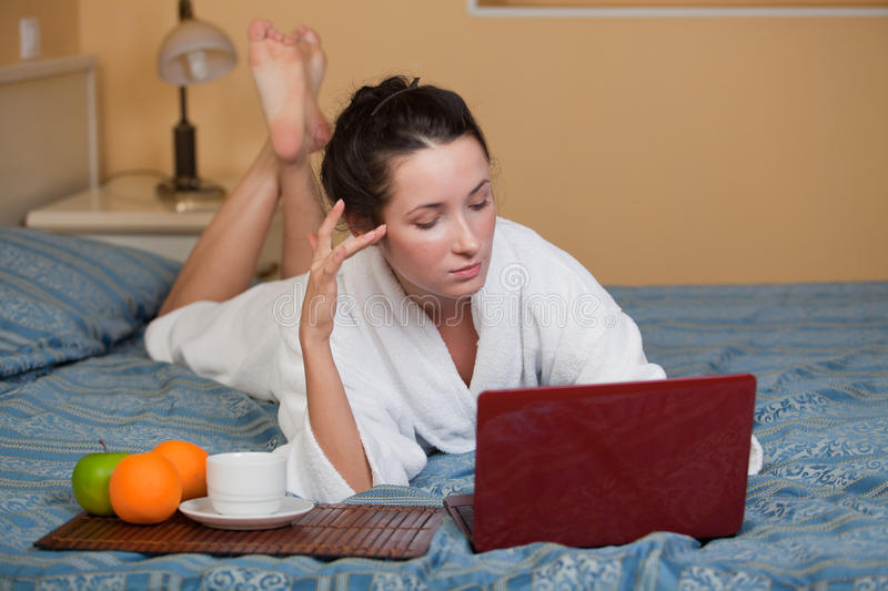 Young woman with laptop. stock image