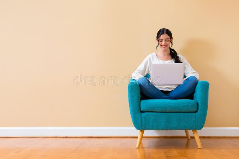 Young woman with a laptop computer stock images