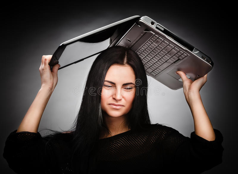 Download Young Woman With A Laptop On Her Head Stock Image - Image: 28897573
