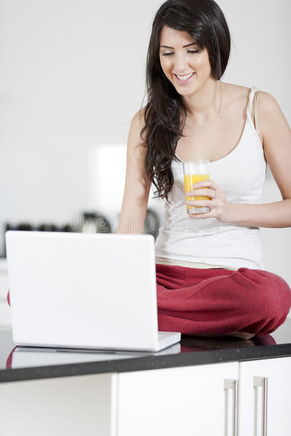 Young Woman On Laptop At Home Royalty Free Stock Image
