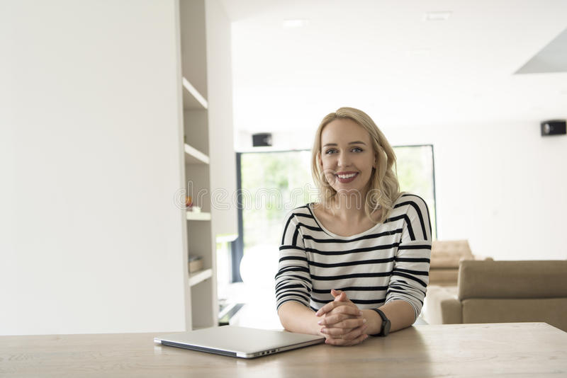Download Young Woman With Laptop At Home Stock Photo - Image: 83700266