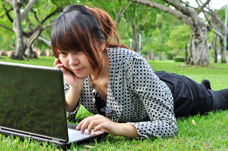 Young woman with laptop in nature royalty free stock photos