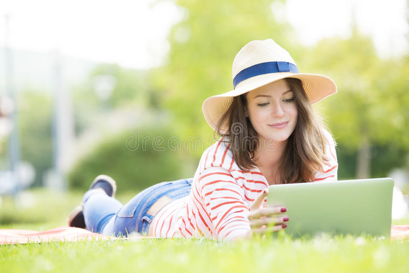 Young woman with laptop outdoor royalty free stock photos