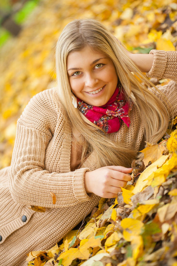 Young woman laying down on the ground stock images