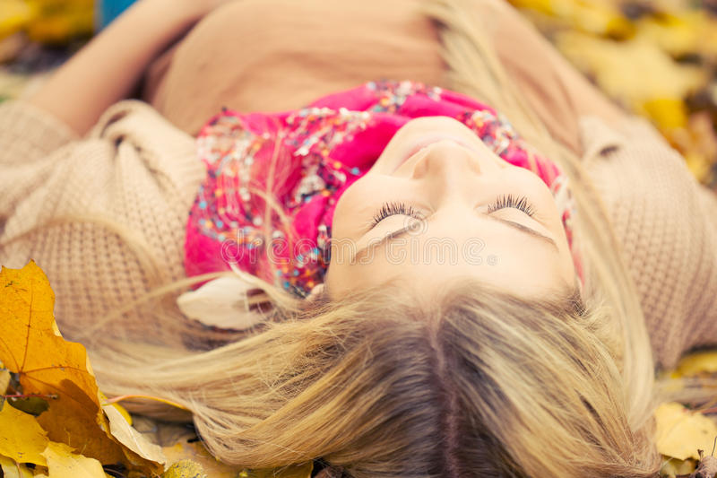 Young woman laying down stock image
