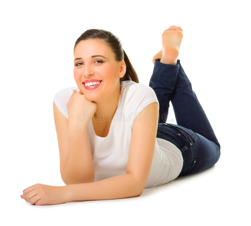 Young woman laying on the floor royalty free stock photo