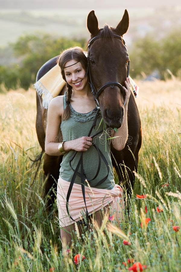 Young Woman Leading Her Horse Stock Image - Image of