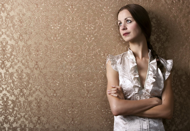 Download Young Woman Leaning Against A Wall Stock Image - Image: 5718103