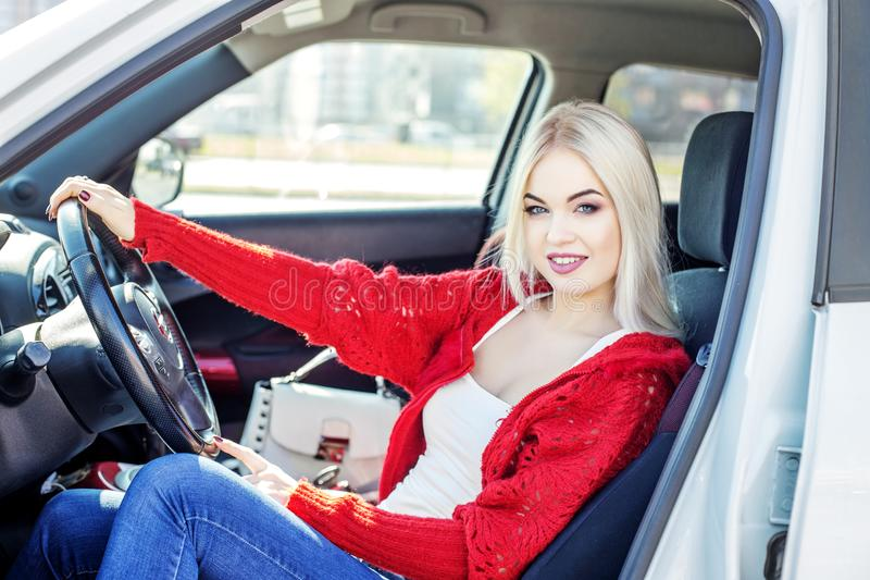 A young woman learns to drive a car. Concept trip, lifestyle, dr stock image