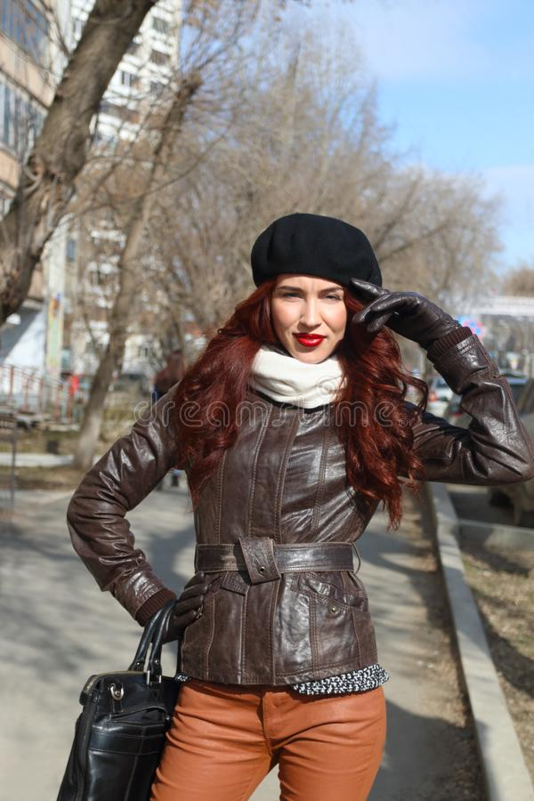 Young woman in leather jacket and gloves stock photos